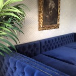 TV Room progress – dreamy blue sectional and banana leaf drapery!